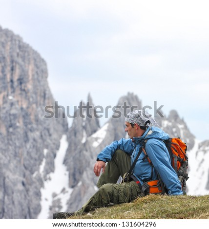 hiker with the high rocky mountains at the background