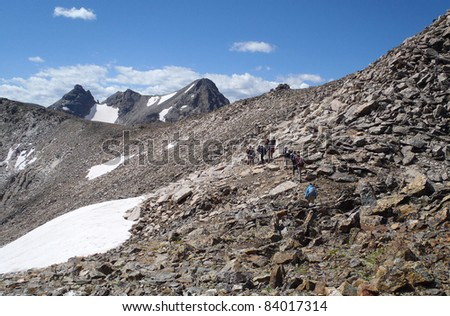 Hikers and climbers on Shoshoni Peak, Colorado's Indian Peaks Wilderness, on the Continental Divide.