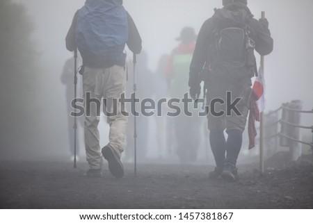 Hikers are walking on Yoshida trail in mist toward the peak of Fuji Mountain, Japan #1457381867