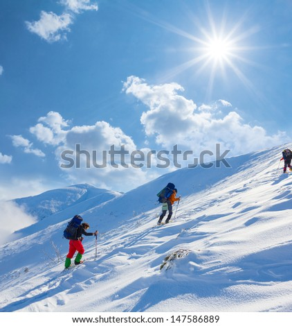 hikers ascent a winter mount slope #147586889