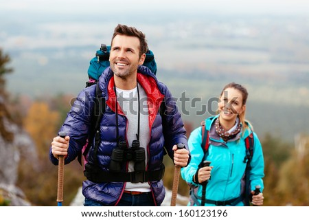 Hikers enjoy the view looking at rocks of Jura, Poland