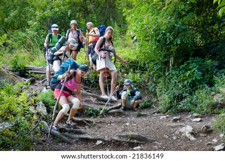 Hikers go down on a stony track