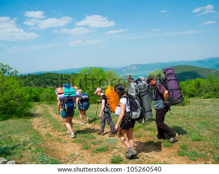 Hikers group walking in Crimea mountains