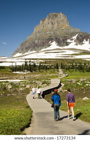 hikers on Hidden Lake Trail in Glacier National Park