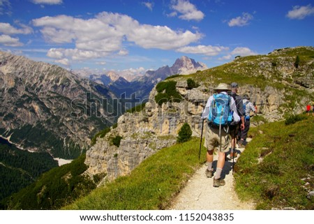 Hikers on steep trail up Monte piana, Dolomites Alps, Italy #1152043835