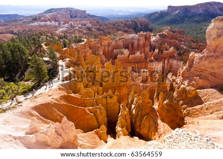 Hikers on the path next to the natural spires at Bryce Canyon National Park which is located in southwestern Utah in the United States