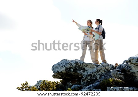 hikers with map pointing in the right direction