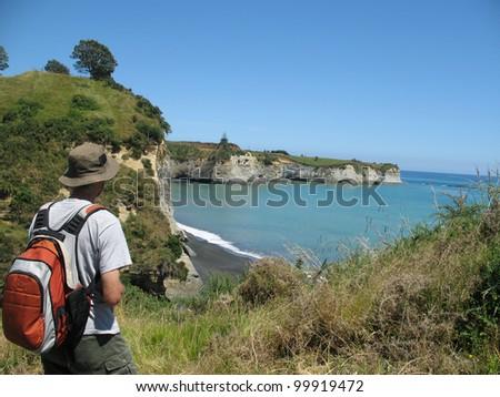 Hiking a coastal walk in Taranaki, New Zealand - stock photo