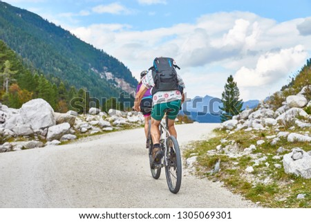 Hiking and biking on a trail in Krimml valley in Austria  #1305069301