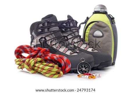 Hiking boots, canteen, two rope and compass reflected on white background