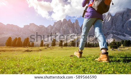 hiking boots close-up. tourist walking at the Puez Odle. Italy #589566590
