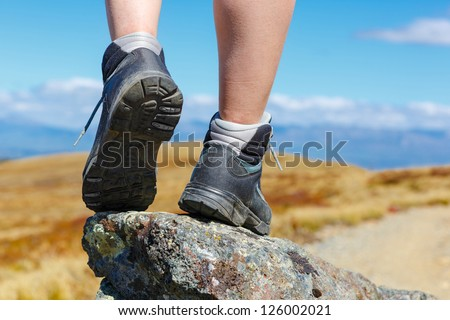 hiking boots on the rock in the mountains