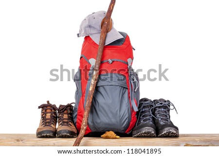 Hiking boots with backpack - stock photo