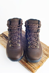 hiking brown boots with sturdy soles on a white background