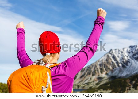 Hiking climbing woman and success in mountains, arms outstretched. Motivation and inspiration concept, Fitness and healthy lifestyle outdoors in wild nature