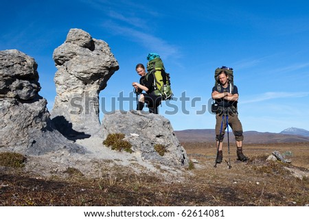 Hiking Couple with backpacks on tour in the wilderness