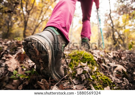 Hiking girl in a mountain. Low angle view of generic sports shoe and legs in a forest. Healthy fitness lifestyle outdoors. Photo stock ©