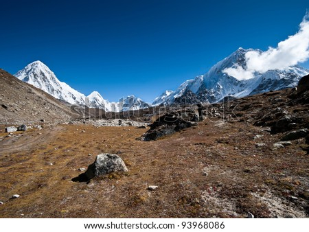 Hiking in Himalayas: Pumori summit and mountains. At height 5000m