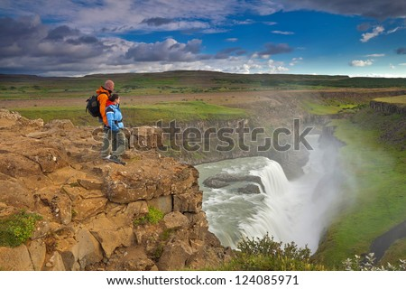 Hiking in Iceland (Island), Gullfoss waterfall - beautiful wild landscape of big waterfalls, green mountains, glaciers and volcanoes