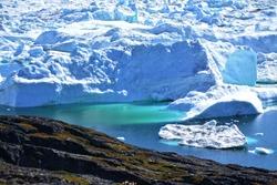 hiking in Ilulissat Greenland - stunning views - beautiful icebergs in the Disko Bay / Baffin Bay - landscae blue sky and ice sea