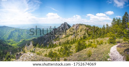 Photo of  Hiking in slovakia moutains. View from the hills. Ostra, tlsta Peak, Velka Fatra. Slovakia