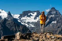 Hiking in the mountains. A person is engaged in Nordic walking in the Caucasus mountains. Girl climber on the way to the top of the mountain. Tourist in the Caucasus mountains. Copy space