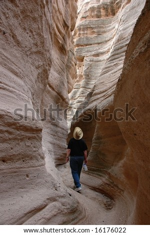 Hiking in the slot canyon at Tent rocks National Monument, New Mexico