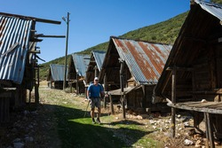 Hiking Lycian way. Man is trekking next to Traditional wooden depots in Bezirgan highlands on Lycian Way trail, Outdoor activity in Turkey