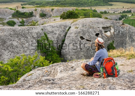 Hiking man having rest at the top of Eski Kermen, Crimea, Ukraine