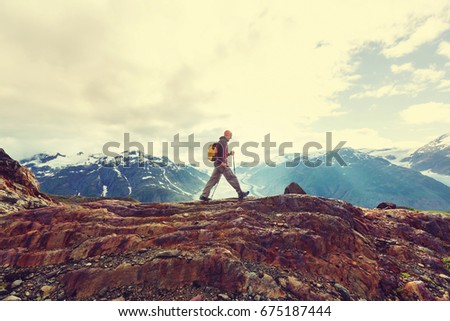 Hiking man in Canadian mountains. Hike is the popular recreation activity in North America. There are a lot of picturesque trails. #675187444