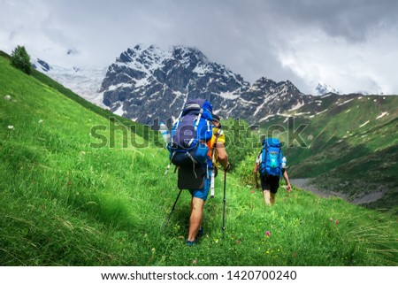 Hiking. Men on hiking trail. Trekking in mountains. Tourists with backpack hike to mountain peak. Sport tourism #1420700240