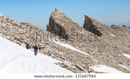 Hiking Mount Whitney. Hikers descending from California's highest mountain peak.