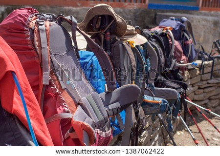 Hiking packs lined up. Tourism, travel and trekking photograph. #1387062422