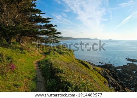hiking path above cliffs  between the Village of Erquy and Plage de Saint Pabu in Bretagne Stock fotó ©