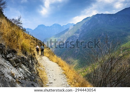 Hiking path (the high road) of Tiger Leaping Gorge. Travelers hiking in the mountains. Located 60 kilometres north of Lijiang City, Yunnan Province, China. #294443054