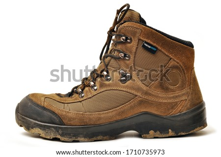 Hiking shoes and a white background, Sturdy hiking boots, strong hiking boots Foto stock ©