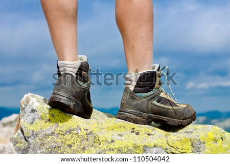 Hiking shoes closeup outdoors on the rock in the mountains