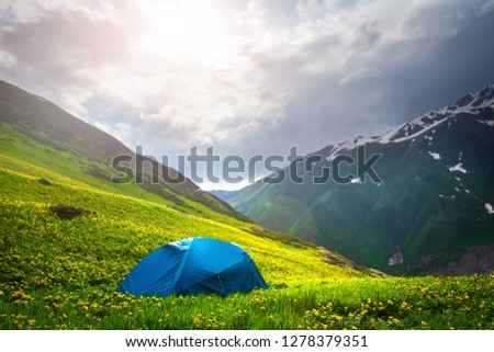 Hiking Tent in mountains. Mountain landscape. Spring nature in highlands. Sunset in Svaneti, Georgia #1278379351