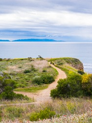 Hiking trail and view from Abalone Cove in California looking out to the Catalina Island in the horizon.