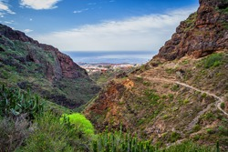 Hiking trail in the Barranco del Infierno - Hell Gorge, view to Adeje town in Tenerife, Canary Islands, Spain