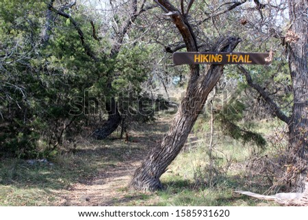 Hiking Trail with a Hiking Trail sign posted on Tree