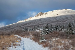 Hiking trail with hoarfrost on the tree of snow covered Seoseokdae Rock of Mudeungsan Mountain at Dong-gu near Gwangju, South Korea