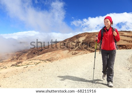 Hiking.  Woman hiker looking at view / copy space in beautiful scenic landscape on volcano Teide, Tenerife, Canary Islands, Spain
