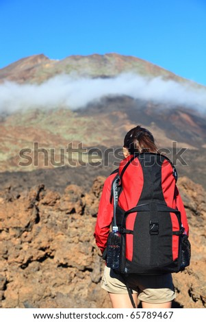 Hiking woman looking at mountain peak. The peak is Pico Viejo on the volcano Teide, Tenerife.