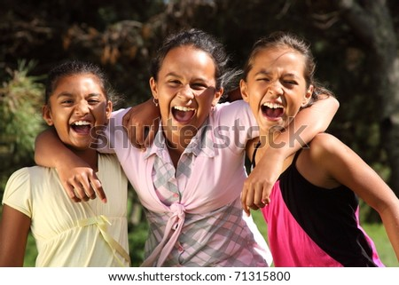 Hilarious laughter between three school girls