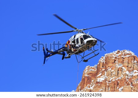 Hildale, UT, USA - March 4, 2015: An Arizona Search and Rescue helicopter crew performs training at Maxwell Canyon, Utah.