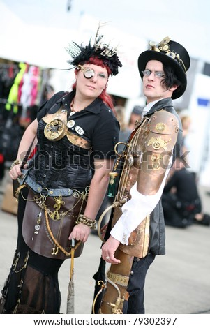 HILDESHEIM, GERMANY - AUGUST 10: Dressed visitors on the gothic music Festival M'Era Luna on August 10, 2010 in Hildesheim, Germany