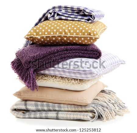 Hill colorful pillows and plaids isolated on white #125253812