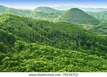 Hills and forests seen from above - stock photo