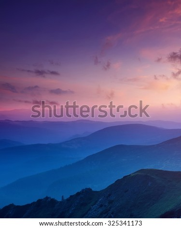 Hills lines in mountain valley during sunset. Natural summer mountain landscape #325341173